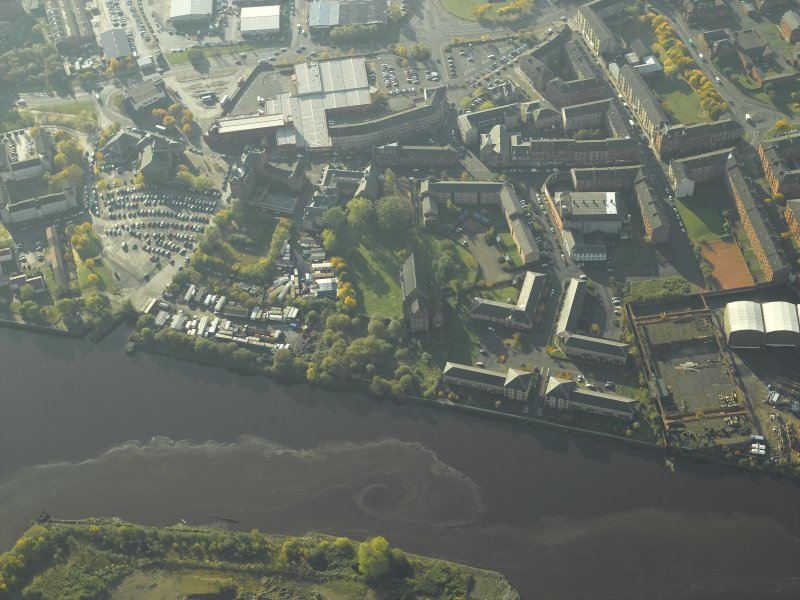 Oblique aerial view centred on the basin and the site of the ship yard with the bridge adjacent, taken from the NNE.