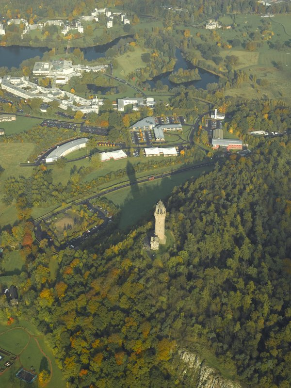 General oblique aerial view centred on the Wallace Monument with the university adjacent, taken from the SSW.