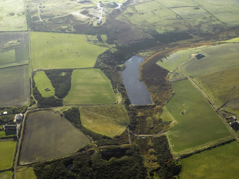 Oblique aerial view centred on the reservoir and the remains of the flint mines, taken from the NNE.