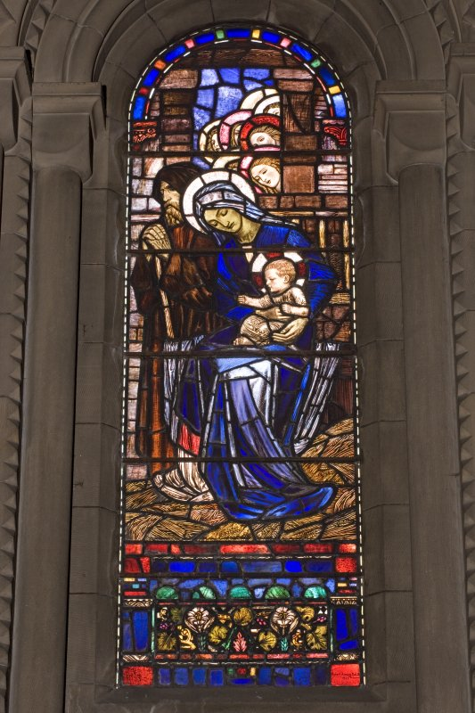 Interior.  Stained glass window depicting the  Virgin and Child designed by R Anning Bell executed by J & W Guthrie