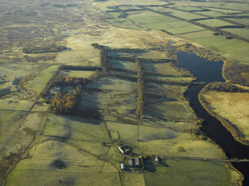 General oblique aerial view centred on the remains of the farmstead, enclosure and rig with the fortified house adjacent, taken from the ENE.