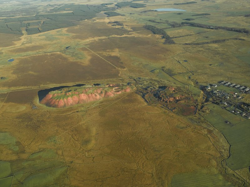 General oblique aerial view centred on the shale-oil works, remains of the shale bings, shale-oil mines and rig, taken from the SW.