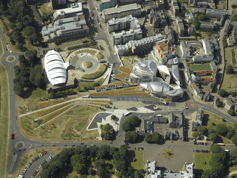 Oblique aerial view centred on the parliament building, conference centre and exhibition centre, taken from the NE.