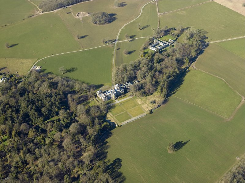Oblique aerial view centred on the country house, garden and farmsteading, taken from the ESE.