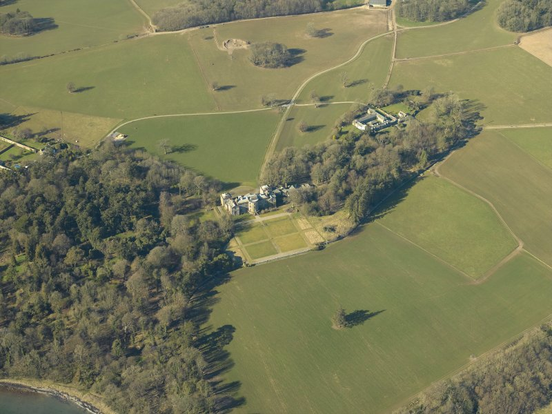 Oblique aerial view centred on the country house, garden and farmsteading, taken from the E.