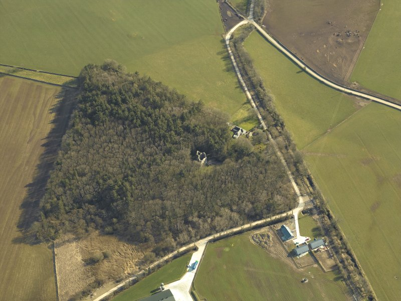 Oblique aerial view centred on the remains of the tower-house, taken from the NW.