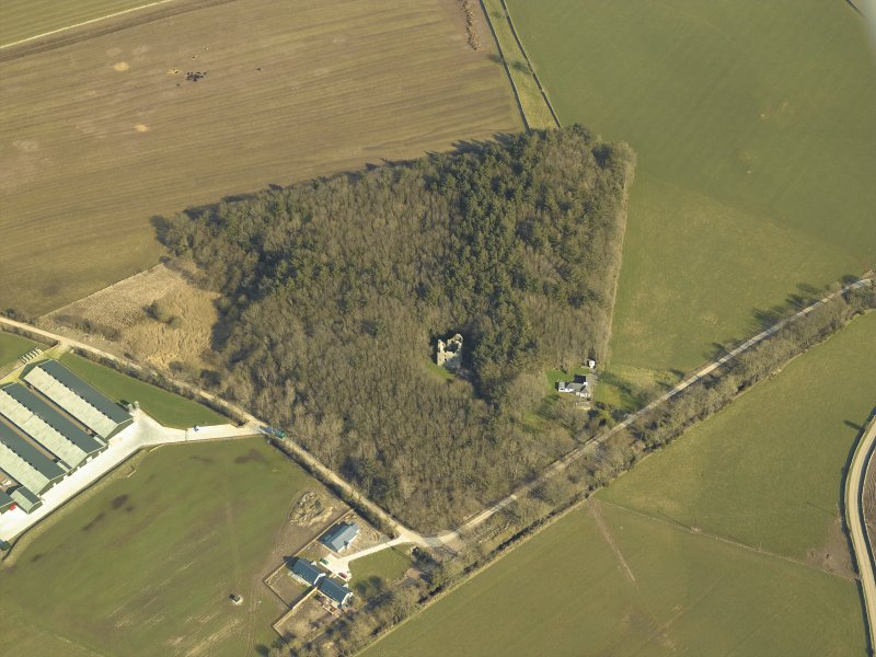Oblique aerial view centred on the remains of the tower-house, taken from the SW.