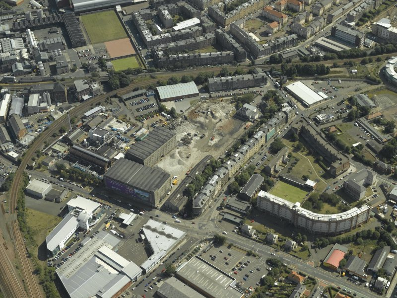Oblique aerial view centred on the bonded warehouse during redevelopment of the site, taken from the WNW.