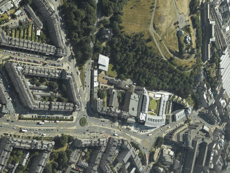 Oblique aerial view centred on the hotel, cinemas and theatre with the observatories adjacent, taken from the NE.