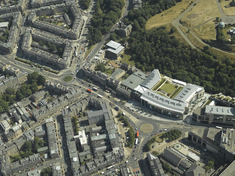 Oblique aerial view centred on the hotel, cinemas and theatre, taken from the W.