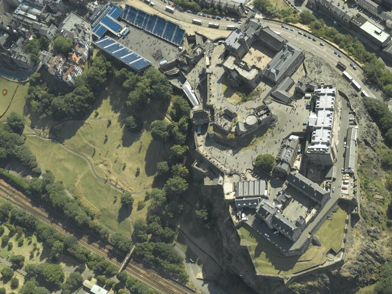 Oblique aerial view centred on the castle with the Military Tattoo stands set up on the esplanade, taken from the NW.