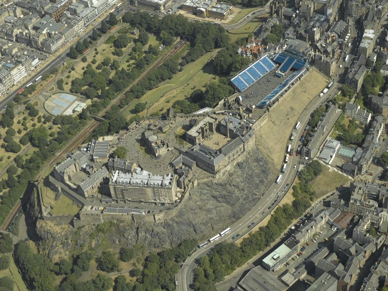 Oblique aerial view centred on Edinburgh Castle with the Military Tattoo stands set up on the esplanade, taken from the SW.