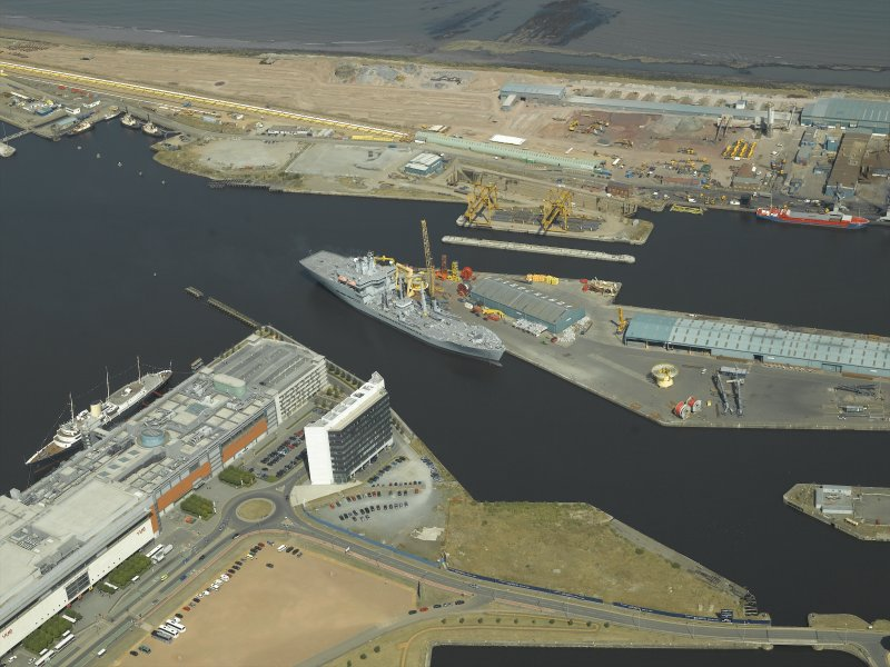 Oblique aerial view centred on the docks, taken from the SSW.