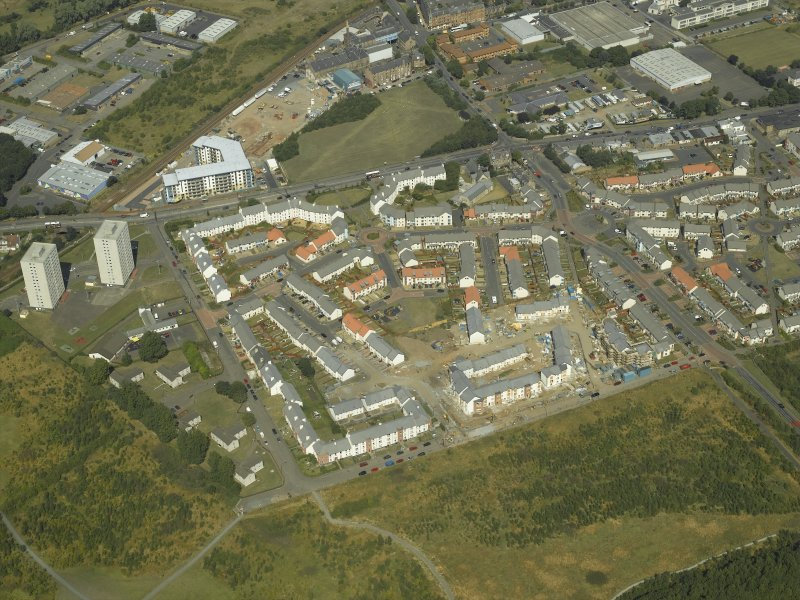 Oblique aerial view centred on the construction of the housing scheme, taken from the SSE.