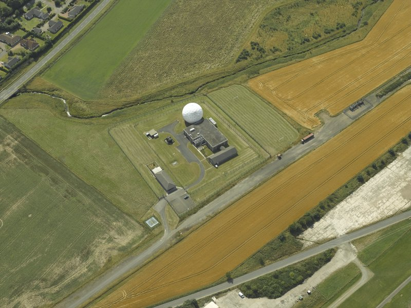 Oblique aerial view centred on the radio station, taken from the NE.