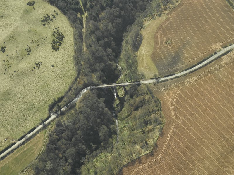 Oblique aerial view centred on the road bridge, taken from the NNW.