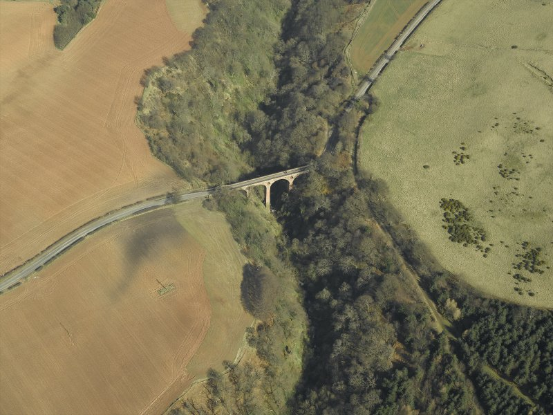 Oblique aerial view centred on the road bridge, taken from the SSW.