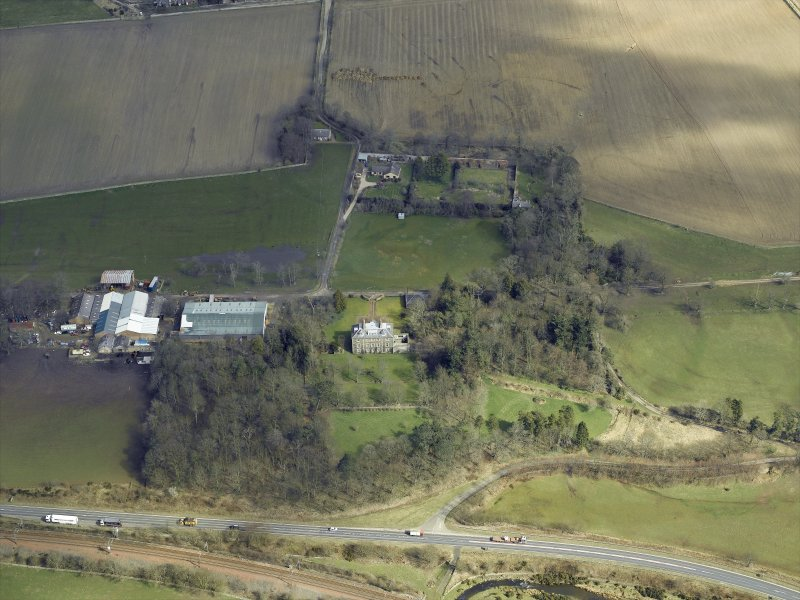 Oblique aerial view centred on the house and the walled garden, taken from the SW.
