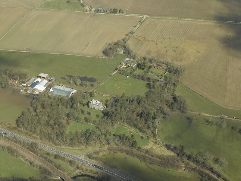 Oblique aerial view centred on the house and the walled garden, taken from the SSW.