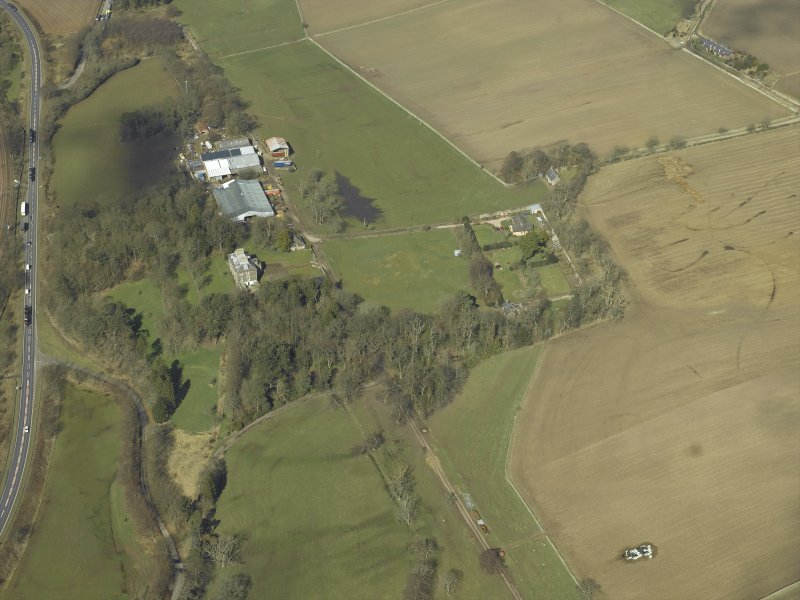 Oblique aerial view centred on the house and the walled garden, taken from the SE.