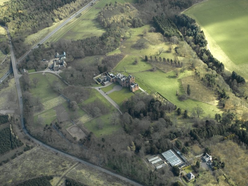 General oblique aerial view centred on the country house, farmsteading, stable and summerhouse, taken from the W.