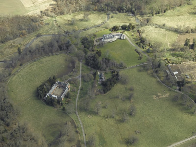 General oblique aerial view centred on the country house, stables and glasshouse, taken from the WSW.