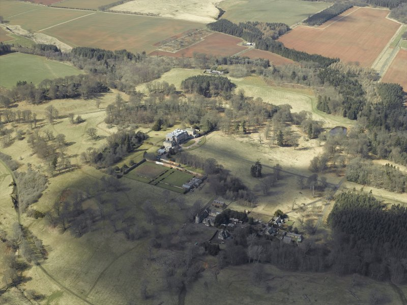 General oblique aerial view centred on the country house and walled garden, with the tower and stable adjacent, taken from the E.