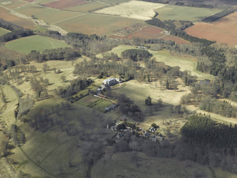 General oblique aerial view centred on the country house and walled garden, with the tower and stable adjacent, taken from the ESE.