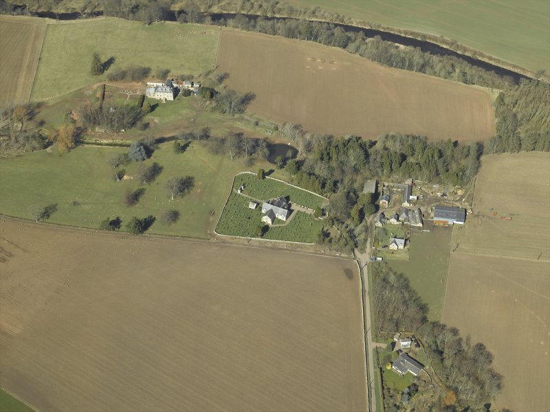General oblique aerial view centred on the churches and burial-ground with the country house, school, farmhouse and farmsteading adjacent, taken from the SSE.