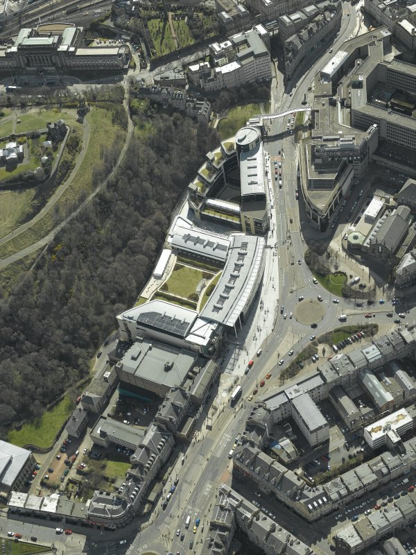 Oblique aerial view centred on the hotel, cinemas and theatre, taken from the NNE.