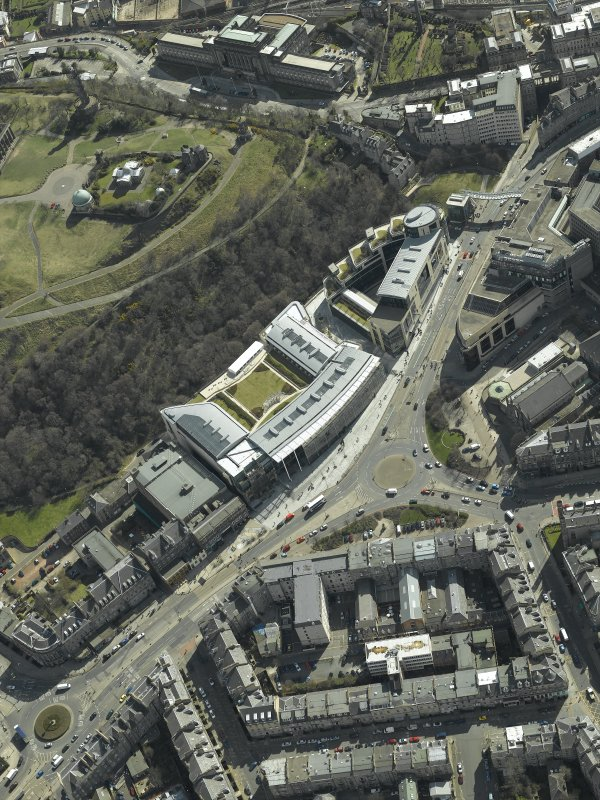 Oblique aerial view centred on the hotel, cinemas and theatre, taken from the NNW.