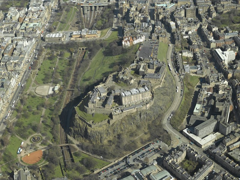 General oblique aerial view centred on the castle with the gardens, bandstand and art galleries adjacent, taken from the W.