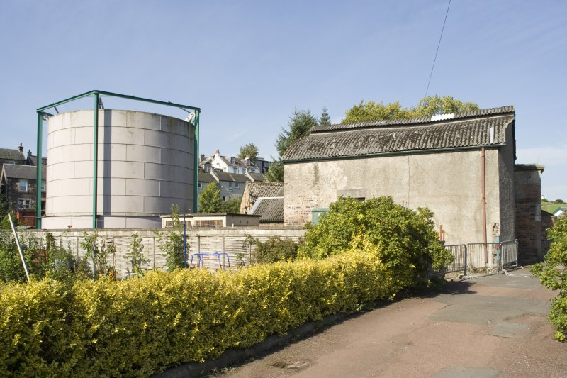 View of retort house (built before 1911) and gas holder which dates from 1879 but subsequently rebuilt. The retort house has a 'Belfast' roof.