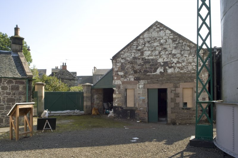 View of main gates to site and former retort house (latterly the coal store) which is now used as an exhibition space