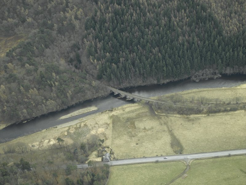 Oblique aerial view centred on the railway viaduct with the cottage adjacent, taken from the NW.