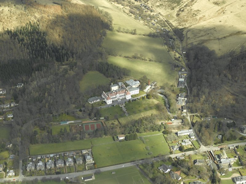 Oblique aerial view centred on the hotel and gate-lodge, taken from the SSW.