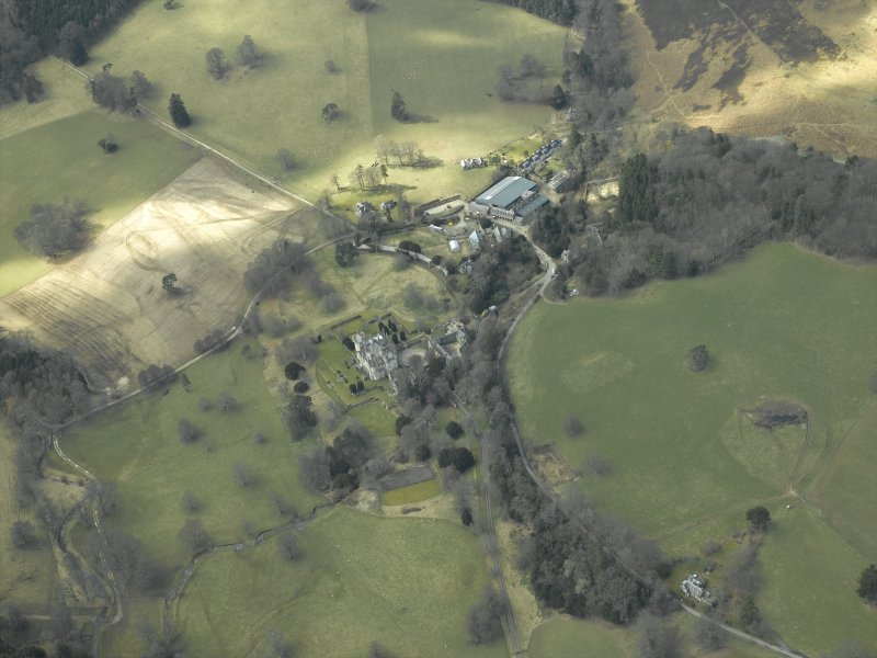 General oblique aerial view centred on the country house, gardens and stable with the walled garden and farmsteading adjacent, taken from the ENE.