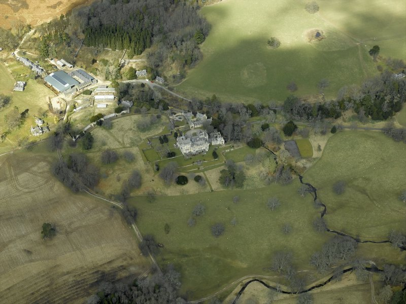 General oblique aerial view centred on the country house, gardens and stable with the walled garden and farmsteading adjacent, taken from the SE.