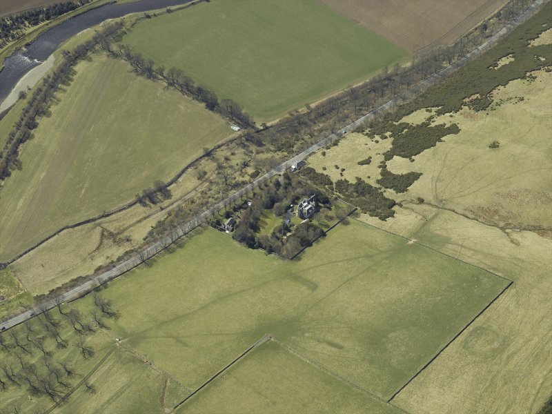 Oblique aerial view centred on the country house and landscaped garden, taken from the NE.