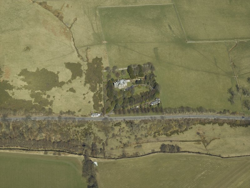 Oblique aerial view centred on the country house and landscaped garden, taken from the S.