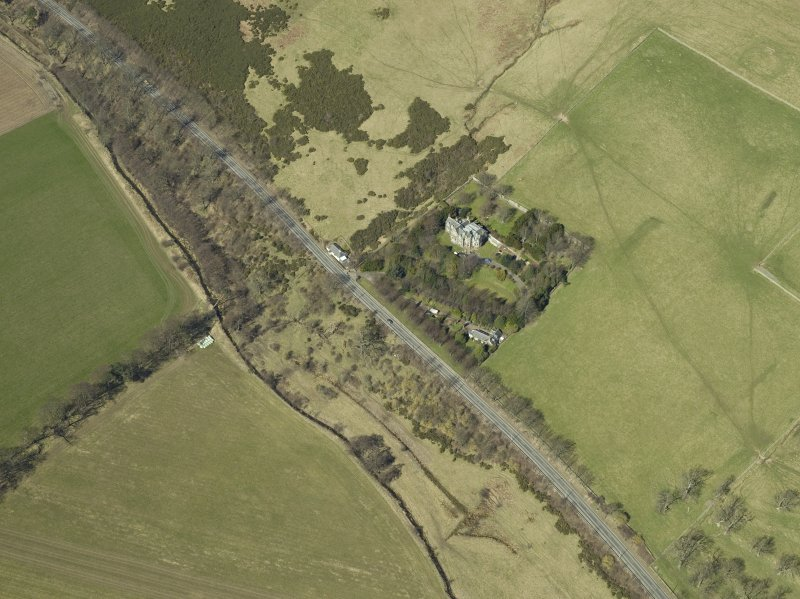 Oblique aerial view centred on the country house and landscaped garden, taken from the SE.
