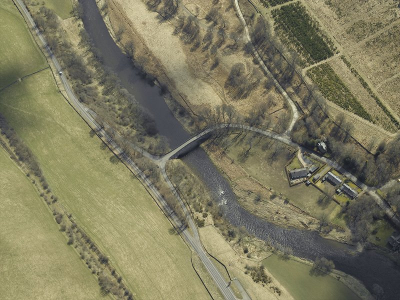 Oblique aerial view centred on the road bridge, taken from the NW.