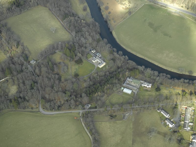 Oblique aerial view centred on the country house with the farmsteading, farmhouse and lodge adjacent, taken from the SSE.