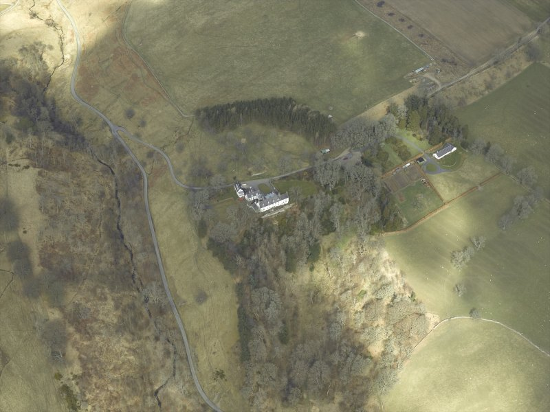 Oblique aerial view centred on country house, taken from the S.