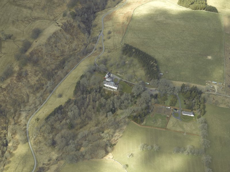 Oblique aerial view centred on country house, taken from the SE.