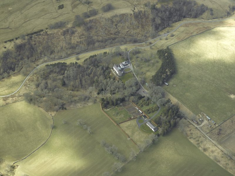 Oblique aerial view centred on country house, taken from the E.
