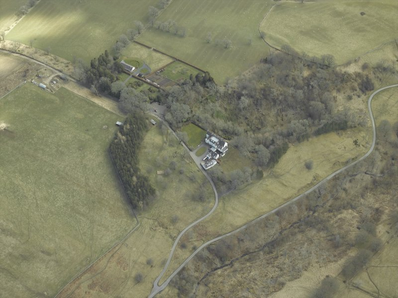 Oblique aerial view centred on country house, taken from the WNW.