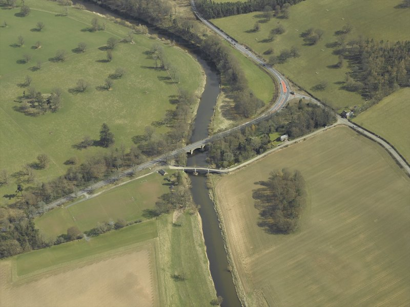 Oblique aerial view centred on the road bridges, taken from the WNW.