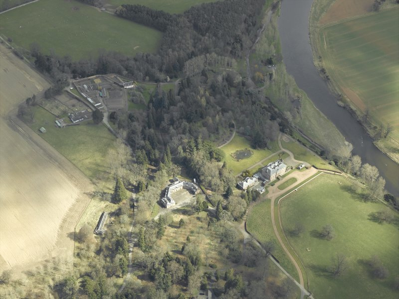 General oblique aerial view centred on the country house, stables and gardens with the house adjacent, taken from the W.