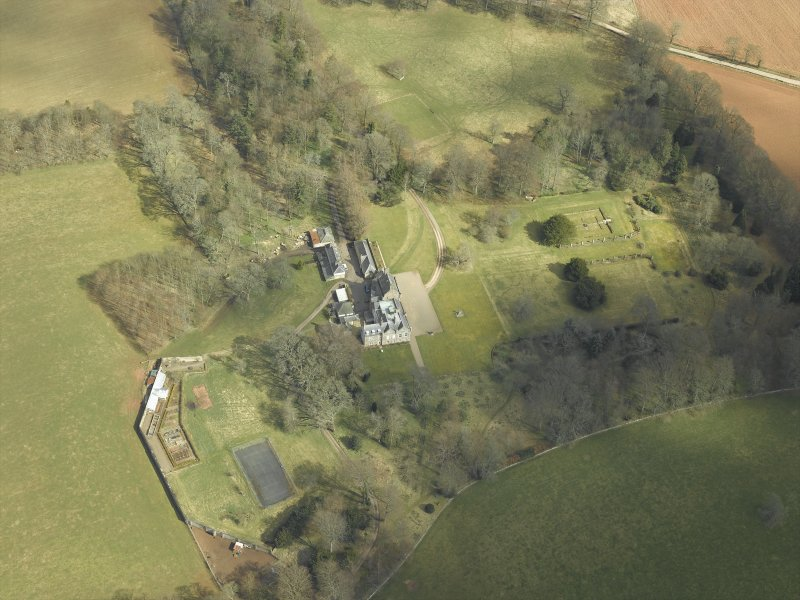 Oblique aerial view centred on the country house and gardens, taken from the WSW.
